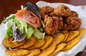 120203-NORCROSS-GA- John Kessler's weekly dine review of Cafe Dominican on Friday February 3, 2012. FOOD: Chicharron de Pollo- fried chicken pieces with a side of plantain.(BECKY STEIN/special)